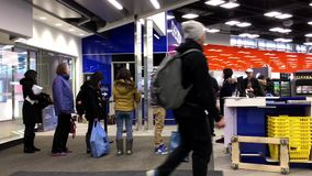 Motion of people line up for paying at check out counter stock video