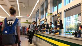 Motion of people line up for paying items at check out counter stock footage