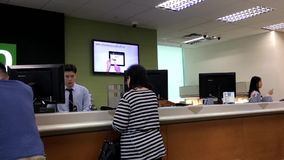 Motion of people line up waiting for the service inside Bank stock video footage