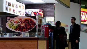 Motion of people ordering food and chatting at food court area stock footage