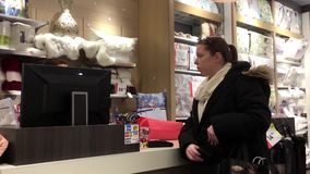 Motion of people paying credit card to buy pillow at mattress store. Inside shopping mall stock video