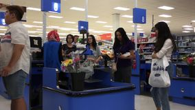 Motion of people paying food at check out counter stock video