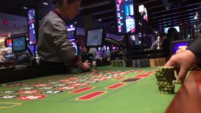 Motion of people playing casino roulette inside Casino. In Coquitlam BC Canada stock video footage