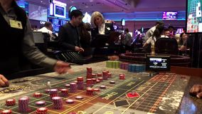 Motion of people playing casino roulette stock footage