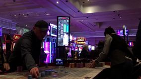 Motion of people playing casino roulette stock video footage