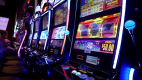 Motion of people playing slot machine stock video