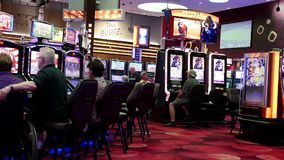 Motion of people playing slot machine stock video footage