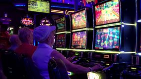 Motion of people playing slot machine