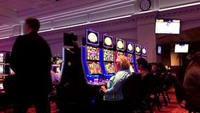 Motion of people playing slot machine stock footage