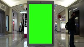 Motion of people shopping and green screen billboard in the middle