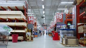 Motion of people shopping inside Home Depot store stock video