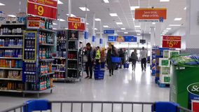 Motion of people shopping with trolley. Inside Walmart store in BC Canada stock video