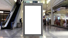 Motion of people shopping and white screen billboard in the middle