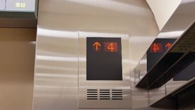 Motion of people taking elevator from three to seven floor. Inside shopping mall stock footage