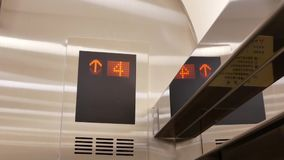 Motion of people taking elevator from tow to seven floor stock video