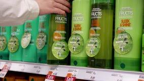 Motion of people taking Garnier fructis shampoo. Inside Shoppers drug mart store stock video