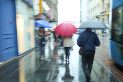 Motion of people with umbrella Stock Images
