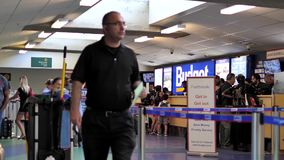 Motion of people waiting on line for renting car in front of Budget rental company stock video