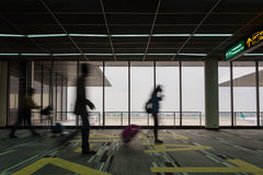 Motion of people walking in airport Royalty Free Stock Images