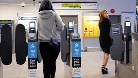 Motion of people walking through the fare pay zone stock video