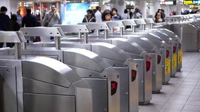 Motion of people walking through the fare pay zone and tapping their card. For taking MRT stock footage
