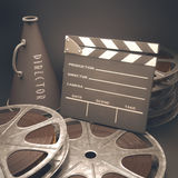 Motion Picture. Clapperboard with rolls of film in the retro concept cinema Royalty Free Stock Photos