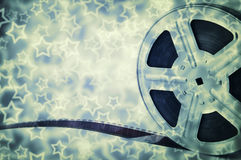 Motion picture film reel with strip and stars Royalty Free Stock Photo