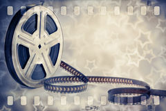 Motion picture film reel with strip and stars. Old motion picture film reel with strip and stars background Stock Image