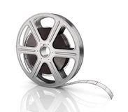 Motion picture film reel. On the white background Stock Photo