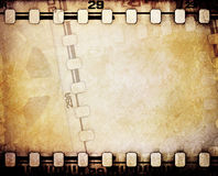 Motion picture reel with film strip. Royalty Free Stock Photography