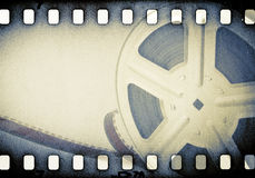 Motion picture reel with film strip. Stock Photos