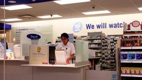 Motion of prescription drop off section. Inside Shoppers drug mart store stock video