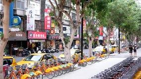 Motion of public rental bike call ubike beside building. stock video footage
