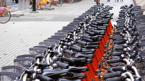 Motion of public rental bike call ubike beside building. stock video
