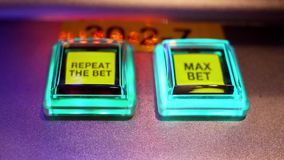 Motion repeat and max bet button on slot machine stock video footage