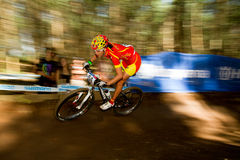 Motion of rider through berm at UCI MTB World Cup Stock Image