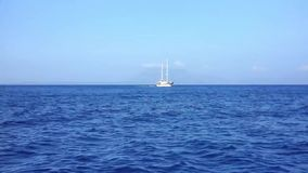 Motion in the sea. Boat is moving on the sea while there is a yacht on distance stock footage