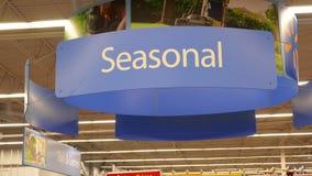 Motion of seasonal sign on sport equipment section. Inside Walmart store stock video