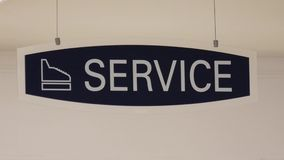 Motion of service sign hanging up the roof stock video