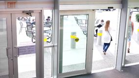Motion of shopper opening door and walking through stock video footage