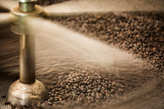 Motion shot coffee beans roaster Royalty Free Stock Photos