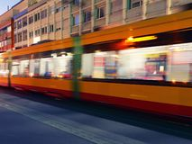 Motion shot public tram at evening. Motion shot of public tram at evening stock photography