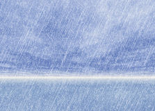 Motion snowfall on a blue clouds sky backgrounds Stock Image