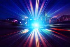 Motion speed light tail effect with modern city in background Royalty Free Stock Image