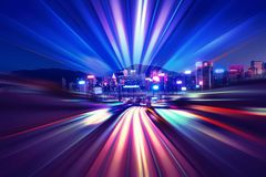 Motion speed light tail effect with modern city in background Royalty Free Stock Photos