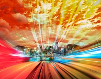 Motion speed light tail effect with modern city in background Stock Image