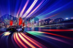 Motion speed light tail effect with modern city in background Stock Photos