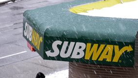Motion of subway store sign with traffic flow stock video