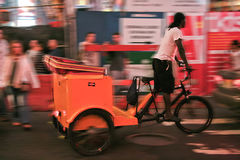 Motion taxi biker Stock Image