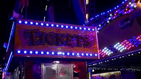 Motion of ticket booth neon sign looped stock video footage